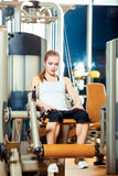 Gym leg extension exercise workout woman indoor Royalty Free Stock Photos