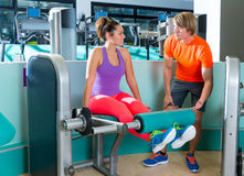 Gym leg extension workout woman personal trainer stock photos