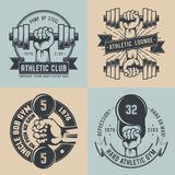Gym logo. In vintage style. Hand with dumbbell, hand with kettlebell - hard athletic logos. Crossfit logo Stock Image