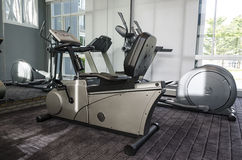 Gym machine. Elliptical cross trainer and  treadmill in club house Stock Photography