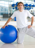 Gym man doing pilates Stock Photography