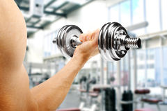 Gym. man with dumbbell in the hand Royalty Free Stock Photos