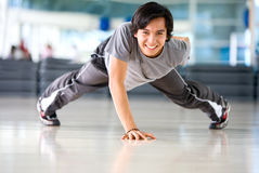 Gym man exercising Royalty Free Stock Photo