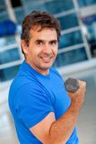 Gym man with free-weights Stock Images