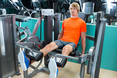 Gym man leg extension cuadriceps exercise Royalty Free Stock Image