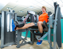 Gym man leg extension cuadriceps exercise Stock Photography