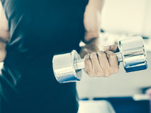 Gym man lifting heavy free weights Stock Image