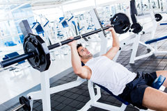 Gym man lifting weights Stock Image