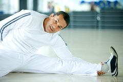 Gym man stretching Stock Photography