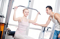Gym man and woman doing exercise Stock Image