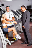 Gym manager greeting customer Stock Photos