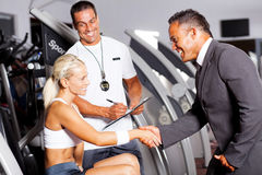Gym manager greeting customer Stock Images