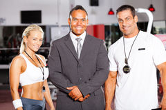 Gym manager and trainers. Group portrait Stock Photo