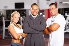 Gym manager and trainers. Happy group gym manager and trainers stock photo