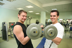 Gym mans with barbell Stock Photo