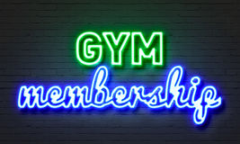 Gym membership neon sign on brick wall background. Stock Images
