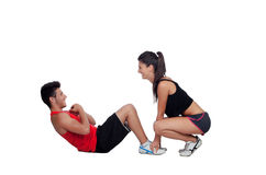 Gym men exercising with his personal trainer Royalty Free Stock Image
