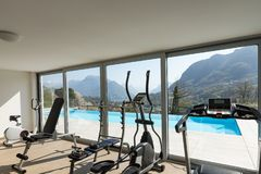 Gym overlooking the pool and hills. Nobody inside royalty free stock images
