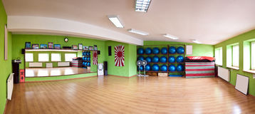 Gym panorama. Panorama of an empty gym room, with large mirror and pilates balls on the shelf Stock Image
