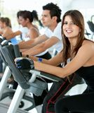 Gym people on cardio machines Stock Photo