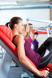 Gym people doing strength or fitness training. Three young women doing strength or sports training in gym for a better fitness Royalty Free Stock Images