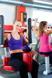 Gym people doing strength or fitness training. Three young women doing strength or sports training in gym for a better fitness Stock Photos