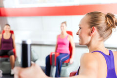 Gym people doing strength or fitness training. Happy, young women doing strength or sports training in gym for a better fitness Stock Photo