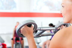 Gym people doing strength or fitness training. Happy, young women doing strength or sports training in gym for a better fitness Royalty Free Stock Images