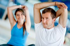 Gym people stretching Royalty Free Stock Photo