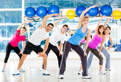 Gym people stretching Royalty Free Stock Images