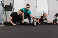 Gym People Stretching And Looking Very Happy Royalty Free Stock Photo