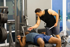 Gym personal trainer royalty free stock photography