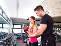 Gym personal trainer man with dumbbell woman Royalty Free Stock Photo