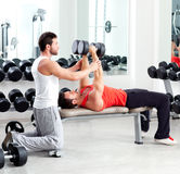 Gym personal trainer man with weight training. Gym personal trainer men with weight training equipment Stock Photography