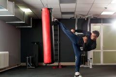 At gym. Photo of boxer training his kick Stock Image