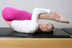 Gym pilates woman reformer yoga leg sport Royalty Free Stock Image