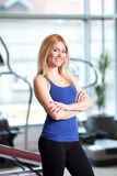 At the gym. Portrait of female gym trainer, shallow depth of field Royalty Free Stock Photography