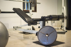 Gym with power dumbell lifting equipment in evening Royalty Free Stock Photography