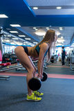In gym. Pretty woman doing squats with barbell Royalty Free Stock Photo