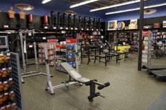 Gym room exercise equipments Royalty Free Stock Images