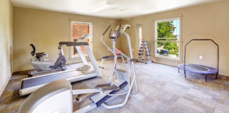 Gym room for residents in Tacomea apartment building. Different exercise equipments and weights Royalty Free Stock Image