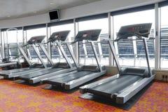 Gym running fitness machines. Gym running machines at sports club stock photo