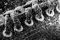 Gym shoe under water. Close-up of gym shoe under water. In B/W royalty free stock photos