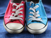 Gym shoes. Blue gym shoe on jeans royalty free stock photography