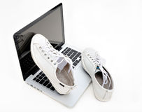 Gym shoes on notebook Royalty Free Stock Photo