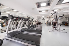 Gym with special equipment, empty. Interior of new modern gym with equipment Stock Image