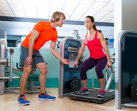 Gym squat machine exercise workout fit woman. Gym squat machine exercise workout fit women at indoor Royalty Free Stock Images