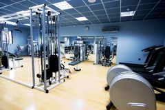 Gym and stationary equipment. Big health room of a gym Stock Photography