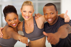 Gym team thumbs up. Happy gym team giving thumbs up Stock Photography