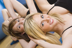 At The Gym Too. Three beautiful young women working out at the gym Royalty Free Stock Photos